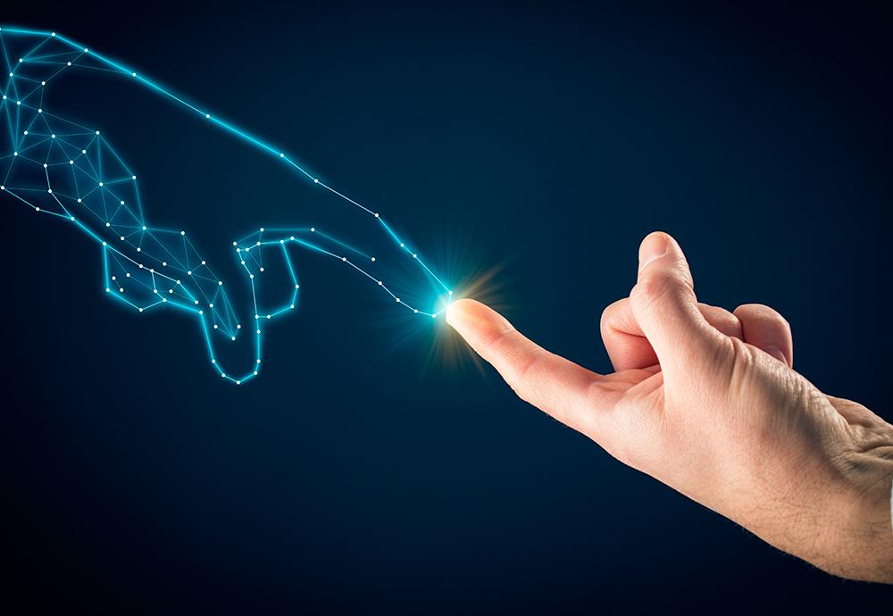 Imagen conceptual de una mano digital y una humana que juntan los dedos índice